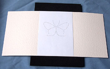 Step 1 lay your blank card onto the pricking mat